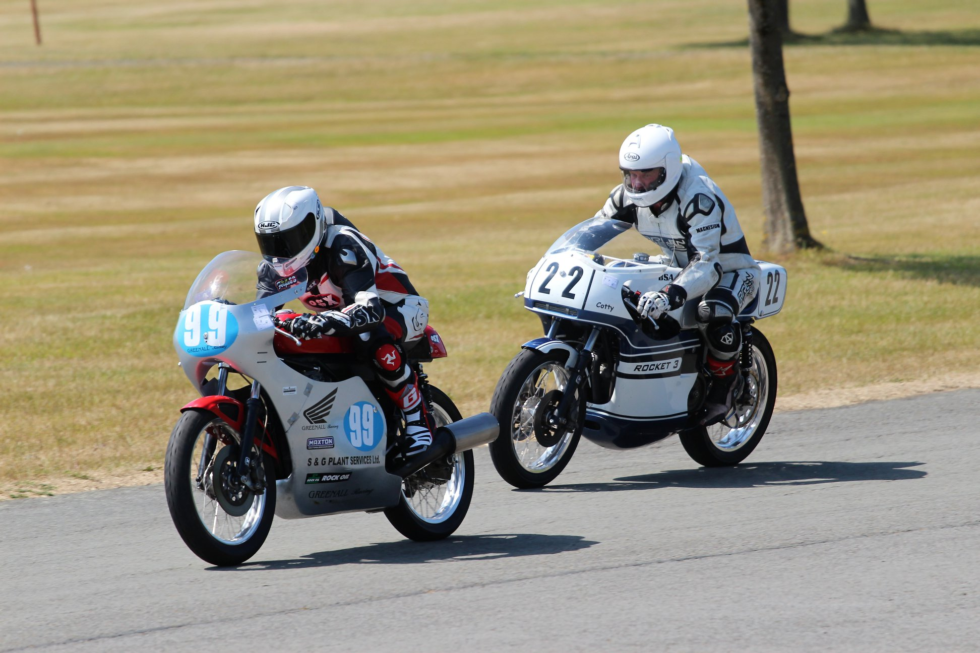 Unlimited Classic winner Derek Heap (22) and all-around classic ace Steve Ferguson (99) jostling for position...
