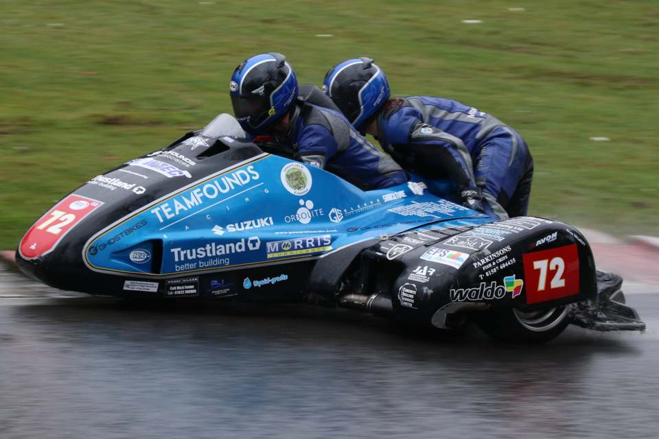 Pete Founds and Jevan Walmsley braving the soggy conditions at Cadwell Park on their way to a win...